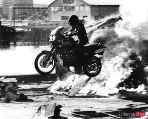 Motorcycle jump through wire and fire