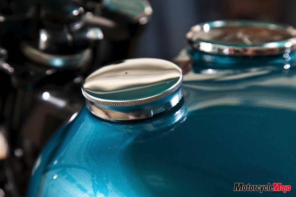 Blue painted gas tank of a 1968 Triumph Bonneville