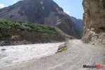 a-road-by-the-panj-river-looking-across-to-afghanistan