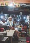 old-granny-smoking-in-night-market-in-pilok