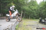 Off-Road Motorcycle Riding Over Ledges