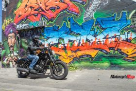 Honda Rebel Riding Past A Painting