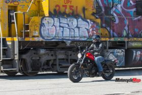 Honda Rebel Riding Past a Train