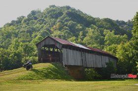 Riding Past a Roofed Bridge in Ohio
