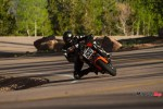 Riding a 2015 KTM Super Duke 1290R By a Forest