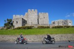 Motorcycle Riding Past A Castle