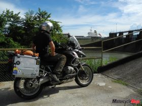 A Motorcycle Rider Observing the Panama Canal