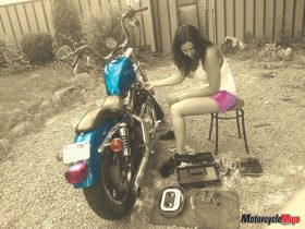 Emily Smith Working on Her Motorcycle