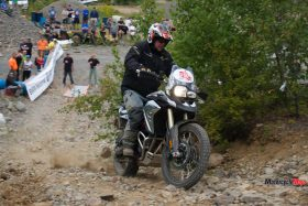 Riding Over a Hill at the GS Trophy Qualifier