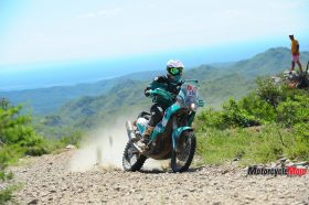 Lyndon Poskitt Motorcycle Riding on a Dirt Road