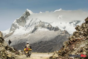motorcycle-riding-past-mountains-in-peru